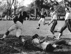 An unidentified Dalhousie player breaks a tackle.