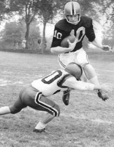 Ted Wickwire, who the Dalhousie field is named after, runs the ball for the Tigers.